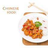 Chicken in tomato sauce with sesame seeds, chili, rice, isolated Stock Photography