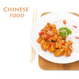 Chicken in tomato sauce with sesame seeds and rice Royalty Free Stock Photos