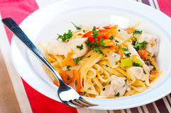 Chicken tomatos oil based pasta Royalty Free Stock Images
