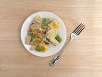 Chicken and tortellini TV dinner on plate with fork Stock Images