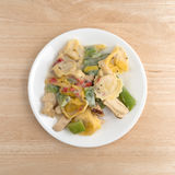 Chicken and tortellini TV dinner on a white plate Royalty Free Stock Photo