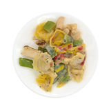 Chicken and tortellini TV dinner on a white plate Royalty Free Stock Photos