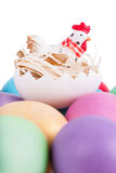 Chicken toy on easter eggs Royalty Free Stock Photography