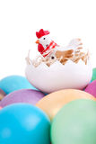 Chicken toy on easter eggs Royalty Free Stock Photos