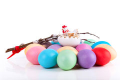 Chicken toy on easter eggs royalty free stock images