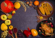 Thanksgiving food concept. Harvest or Thanksgiving background. Chicken or turkey, autumn fruits and vegetables: corn, pumpkin, paprika, apples. Cranberry sauce royalty free stock photos