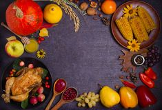 Thanksgiving food concept. Harvest or Thanksgiving background. Chicken or turkey, autumn fruits and vegetables: corn, pumpkin, paprika, apples. Cranberry sauce royalty free stock photography