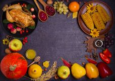 Thanksgiving food concept. Harvest or Thanksgiving background. Chicken or turkey, autumn fruits and vegetables: corn, pumpkin, paprika, apples. Cranberry sauce stock photography