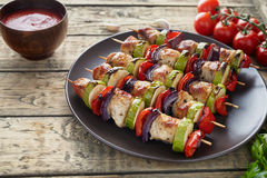 Chicken or turkey meat kebab skewerrs with onion and tomatoes Royalty Free Stock Photo
