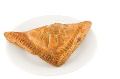Chicken turnover pie. Picture of a chicken turnover pie on a plate Royalty Free Stock Photo