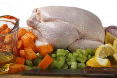 Chicken and veg with oil Royalty Free Stock Image