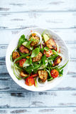 Chicken and vegetable salad with fresh herbs in a bowl Stock Photos