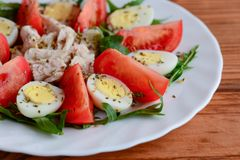 Homemade vegetable chicken salad for lunch or dinner. Healthy salad with fresh tomatoes, rocket, quail eggs, chicken fillet stock images