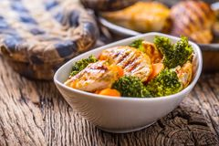 Chicken and vegetable salad. Pieces of grilled chicken with carrots and broccoli Royalty Free Stock Image
