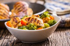 Chicken and vegetable salad. Pieces of grilled chicken with carrots and broccoli.  Royalty Free Stock Photography