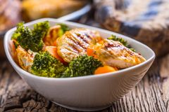 Chicken and vegetable salad. Pieces of grilled chicken with carrots and broccoli Royalty Free Stock Photo