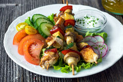 Chicken and vegetable skewers. With garlic dip and salad stock image