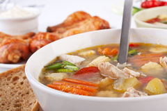 Chicken and vegetable soup Stock Images