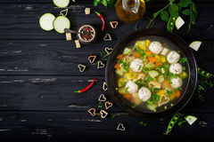 Chicken and vegetable soup with meatballs, zucchini and pasta. Flat lay. Top view Royalty Free Stock Photography