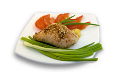 Chicken with vegetables. Chicken with green onions and tomatoes Royalty Free Stock Photos