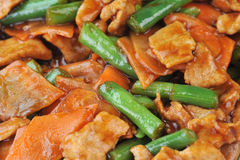 Chicken with vegetables. Chinese cuisine. deep fried chicken with red sauce and beans royalty free stock image