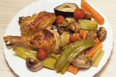 Chicken and vegetables baked in oven Stock Images