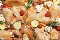 Chicken and vegetables baked in oven Stock Image