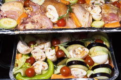 Chicken and vegetables baked in oven Royalty Free Stock Photography