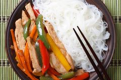 Chicken with vegetables and rice noodles closeup. top view Stock Image