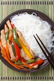 Chicken with vegetables and rice noodles top view vertical Royalty Free Stock Photos