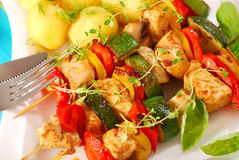 Chicken and vegetables skewers. Grilled chicken and vegetables skewers with potato for dinner Stock Photo