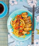Chicken with vegetables in teriyaki sauce in Japanese Stock Photo