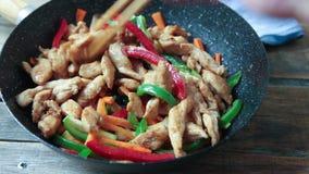 Chicken and veggies wok stock footage