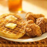 Chicken and waffles. With sweet tea in background Stock Images