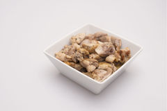 Chicken in a white bowl. On a white background Stock Image