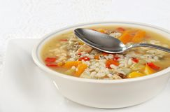 Chicken and wild rice soup with spoon Royalty Free Stock Images