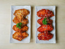 Chicken wings fried. Chicken wing crispy fried with garlic and korea sauce on plate on wood table in restaurant.top view Stock Image