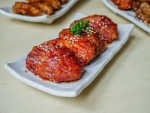 Chicken wings fried. Chicken wing crispy fried with korea sauce on plate on wood table in restaurant Stock Photos