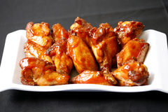 Chicken wings. As side order with pizza Royalty Free Stock Photos