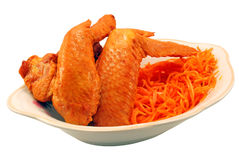 Chicken wings. And Korean carrot stock photography