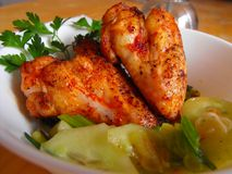 Chicken wings. Spicy chicken wings with cucumber salat Stock Photo
