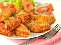 Chicken wings. Hot chicken wings with salad royalty free stock photos