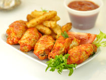 Chicken wings. Hot chicken wings with salad and fried potato stock photo