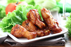 Chicken wings. Plate of chicken wings and vegetable Stock Photos