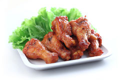 Chicken wings. Plate of chicken wings on white background Royalty Free Stock Photography
