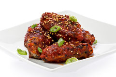 Chicken Wings. Korean-style fried chicken wings with spicy sauce Stock Photography