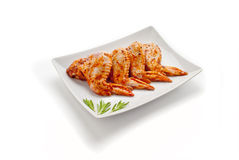 Chicken wings. In marinade on a plate Stock Photography