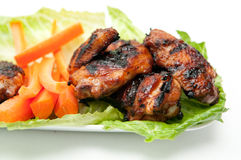 Chicken wings. Barbeque chicken wings with sauce and carrot sticks Stock Images
