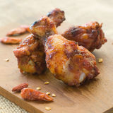 Chicken wings. Fried chicken wings with chilli, selective focus Stock Image