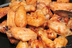 Chicken wings. A full plate of chicken wings garlic and sweet royalty free stock photography